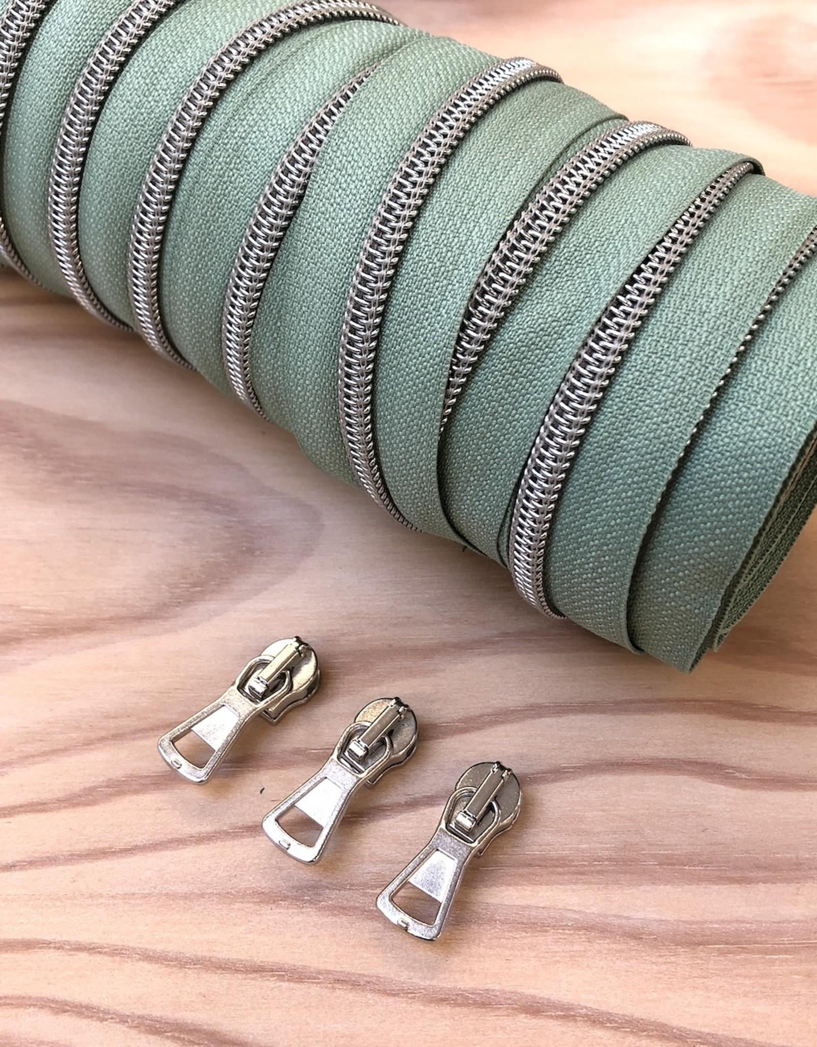 1 m spiraalrits mint/zilver  +  3 schuivers