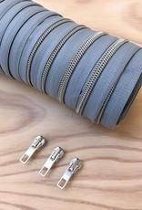 1 m spiraalrits blauw/zilver  +  3 schuivers