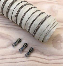 1 m spiraalrits ecru/oxyd +  3 schuivers