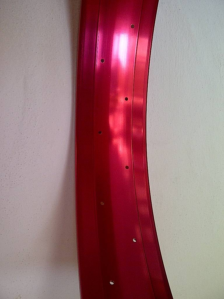 "alloy rim DW100, 26"", red anodized"