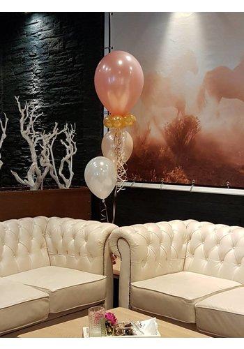 Tafeldecoratie met grote topballon