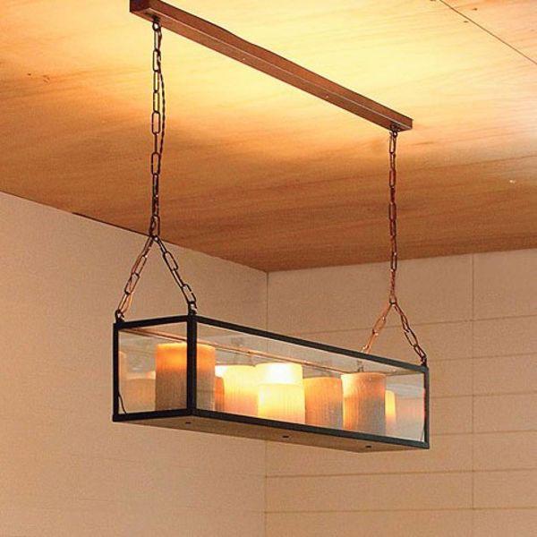 Suspension en bronze avec bougies LED dynamiques