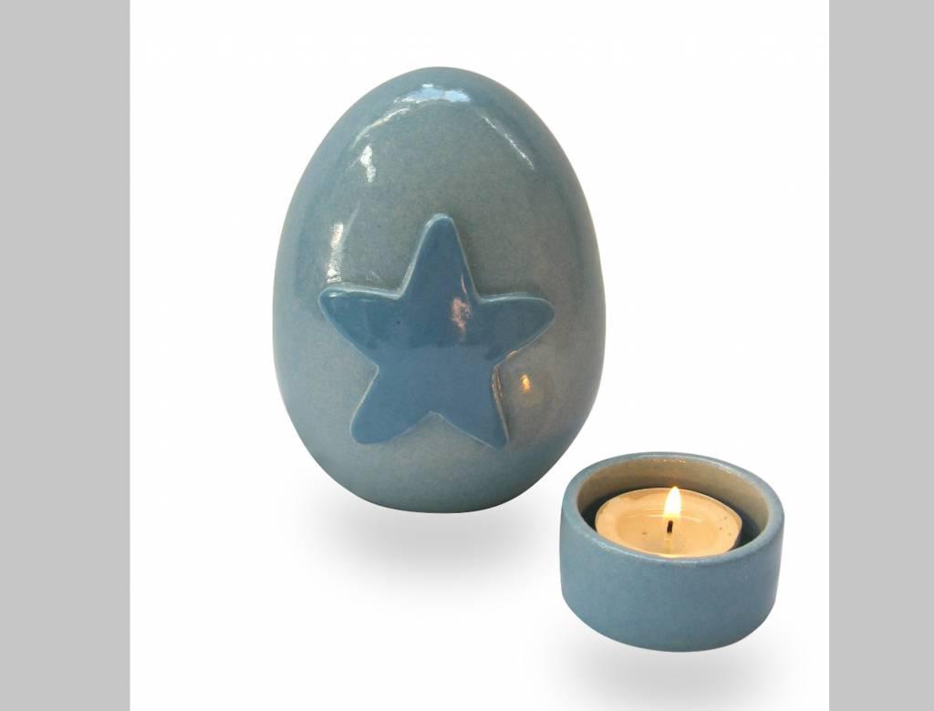 Urn met blauwe ster