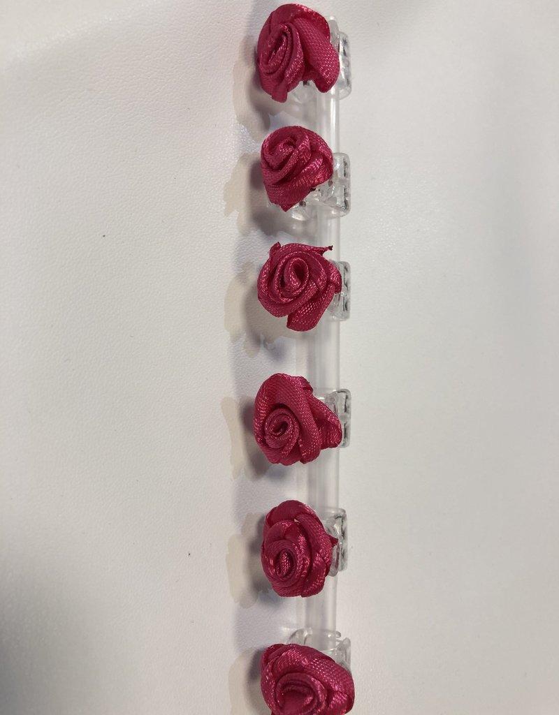 Roosjes hard roze op rietje 6 stuks