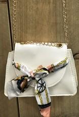 Tasje off white met strik en goudkleurig  hengsel