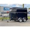 HOWK Paardentrailer huren? 2 paards trailer met zadelkamer