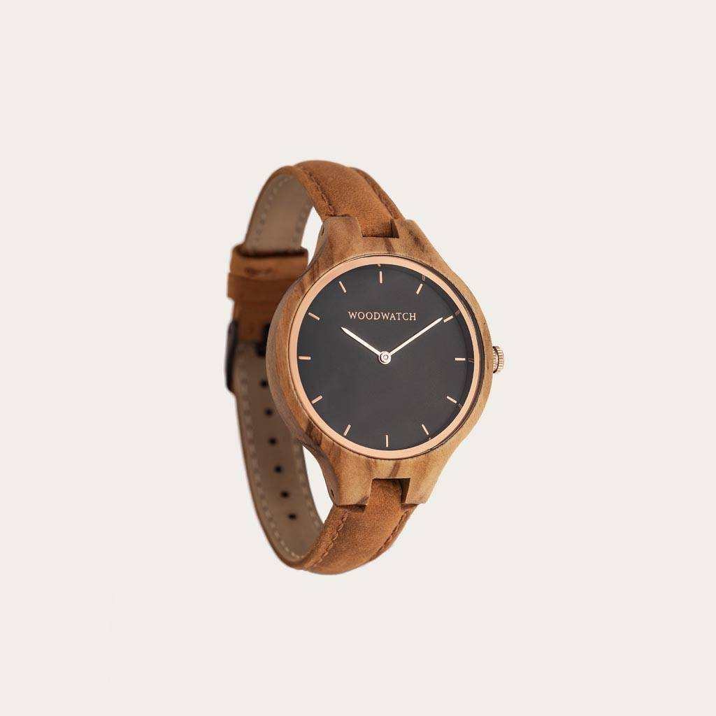 The AURORA Collection breaths the fresh air of Scandinavian nature and the astonishing views of the sky. This light weighing watch is made of European Olive Wood, accompanied by a stainless-steel sky-black dial and starry rose-gold details. The Amber Band