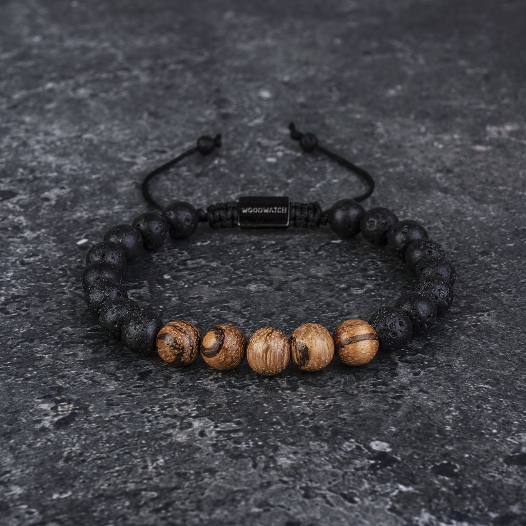 Our handmade Sandalwood Volcanic Beads Bracelet features a combination of 8mm Sandalwood and Volcanic beads. This bracelet is adjustable and fits most wrist sizes. The perfect accessory to go with any WoodWatch.