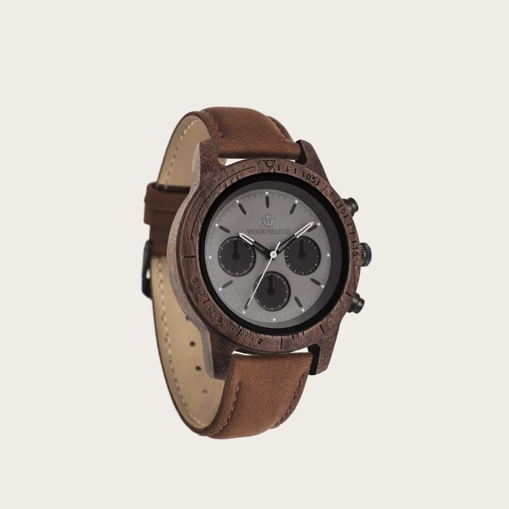 Axinite Black Pecan features a classic SEIKO VD54 chronograph movement, scratch resistant sapphire coated glass and pecan strap. Made from American Walnut Wood and handcrafted to perfection. The watch is available with a wooden strap or a leather strap.
