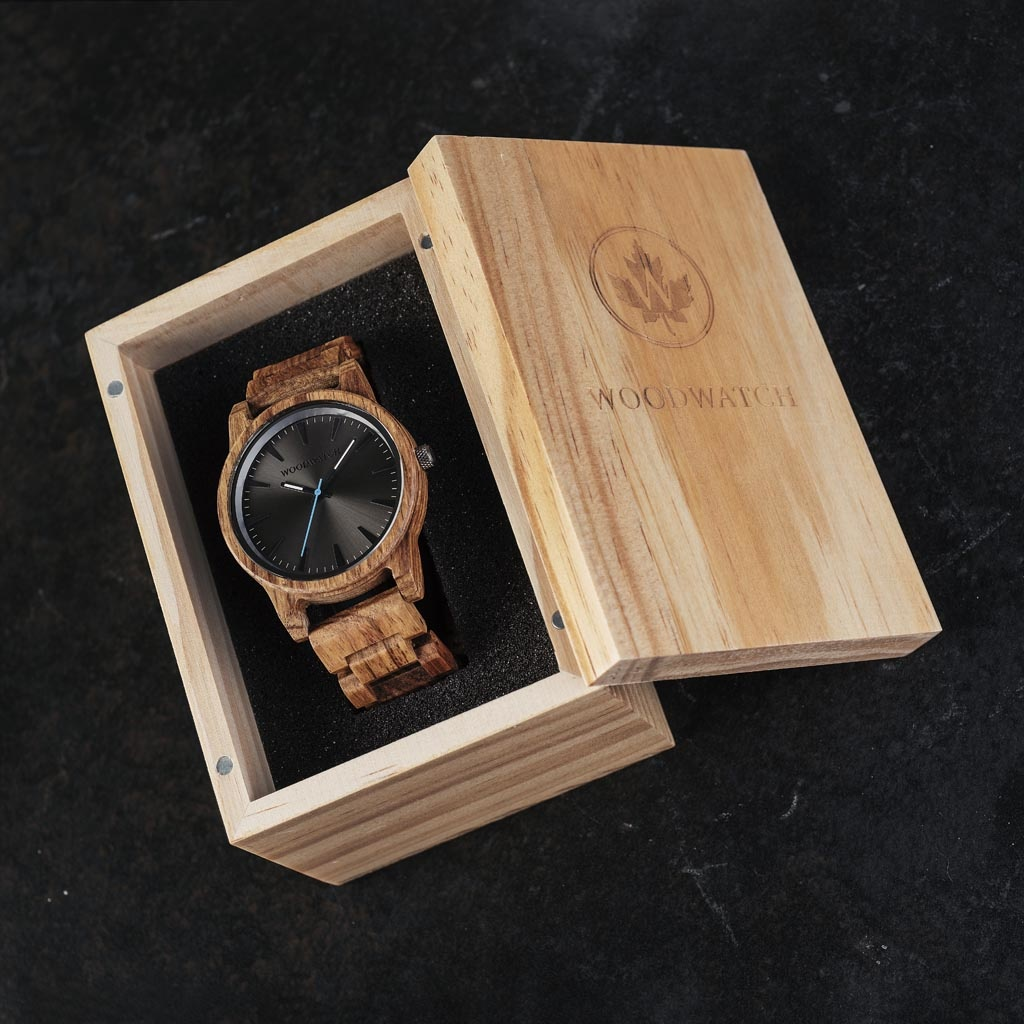 The Reveler Kosso features a modernized minimal grey dial with bold details in a 45mm case. A wrist essential combining natural wood with stainless steel and sapphire coated glass. The Reveler Kosso is handmade from natural Kosso wood from East Africa.
