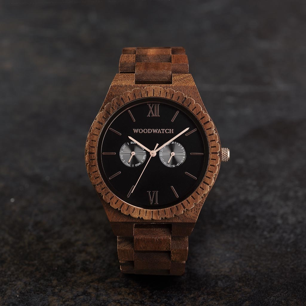 This premium designed watch combines natural wood type with a luxurious stainless steel dial and backplate. At the heart of the timepiece is a multi-function movement with two subdials featuring a week and month display. The GRAND Dark Orion is made of Ac