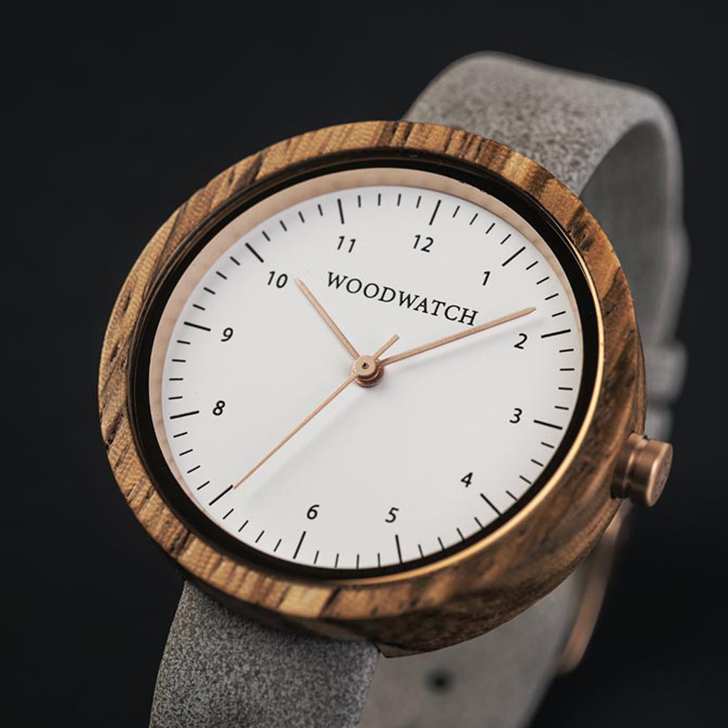Inspired by contemporary Nordic minimalism. The NORDIC Oslo features a 36mm diameter white zebra wood case with white dial and rosegold details. Handmade from sustainably sourced wood combined with an ultra soft grey leather strap.