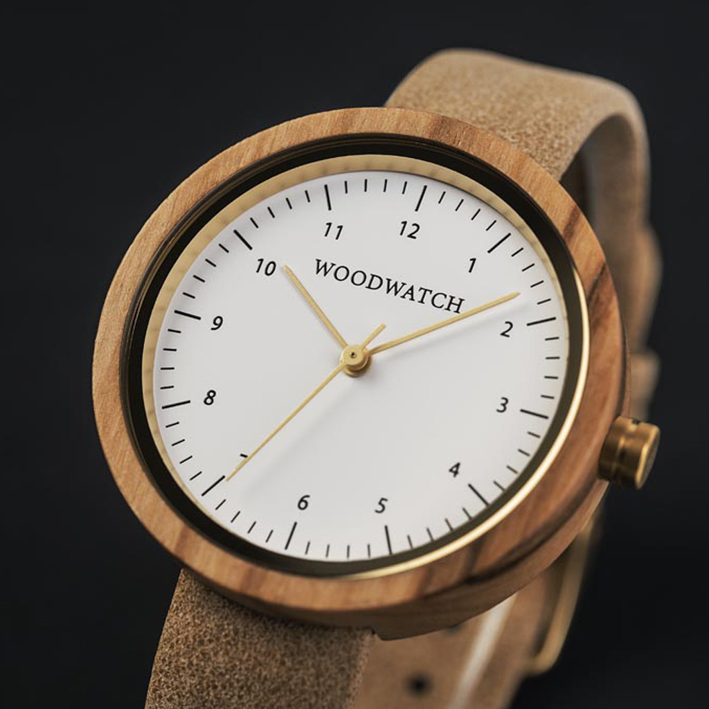 Inspired by contemporary Nordic minimalism. The NORDIC Copenhagen features a 36mm diameter white olive wood case with white dial and gold details. Handmade from sustainably sourced wood combined with an  ultra soft beige leather strap.