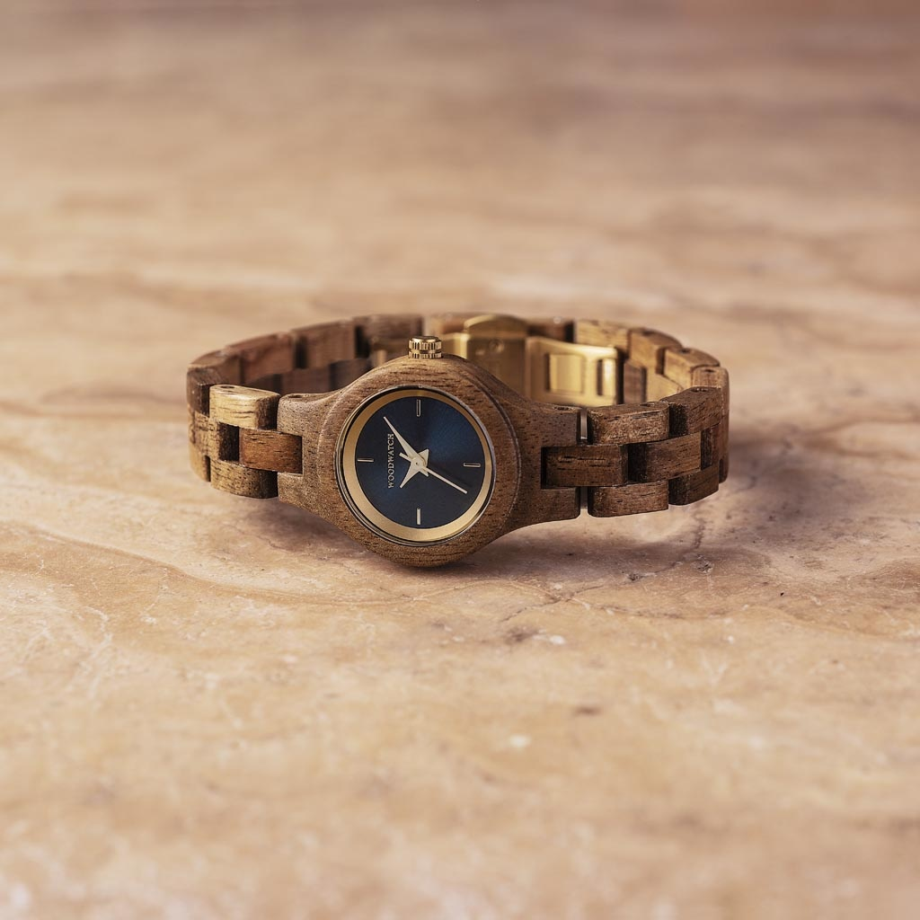 The Bellflower watch from the FLORA Collection consists of acacia wood that has been hand-crafted to its finest slenderness. The Bellflower features a dark navy blue dial with golden coloured details.