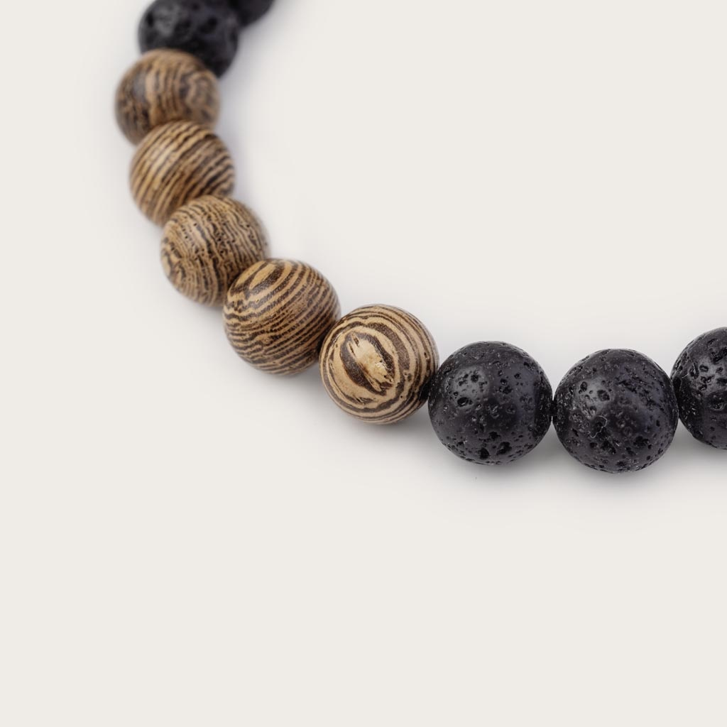 Our handmade Wengewood Volcanic Beads Bracelet features a combination of 8mm Wengewood and Volcanic beads. This bracelet is adjustable and fits most wrist sizes. The perfect accessory to go with any WoodWatch.