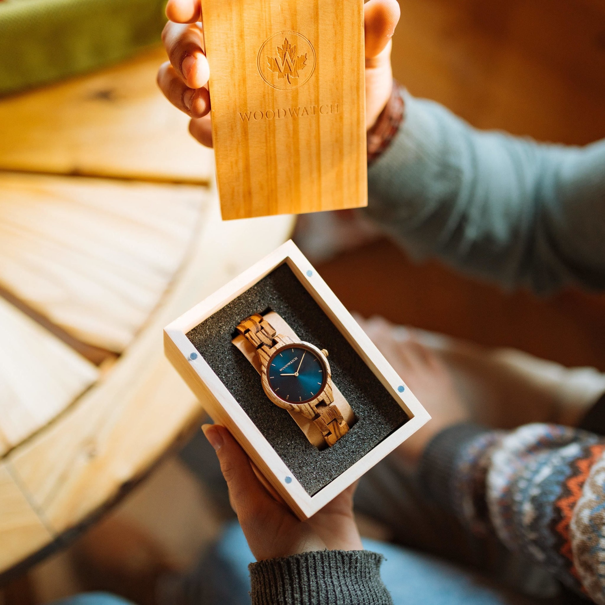 The AURORA Collection breaths the fresh air of Scandinavian nature and the astonishing views of the sky. This light weighing watch is made of West-African Zebrawood, accompanied by a blue stainless-steel dial with golden details.<br /> The watch is available w