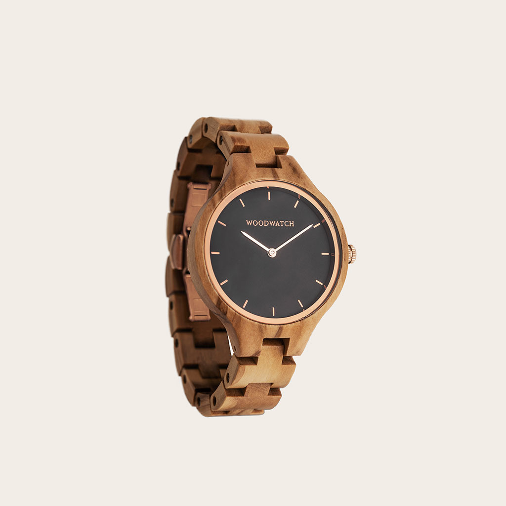 The AURORA Collection breaths the fresh air of Scandinavian nature and the astonishing views of the sky. This light weighing watch is made of European Olive Wood, accompanied by a stainless-steel sky-black dial and starry rose-gold details. The watch is a