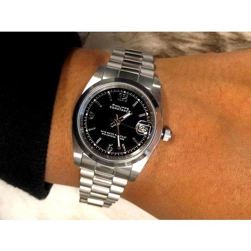 Stalen Philippe Constance Horloge Philippe Constance Stalen Dameshorloge - 7440 Medium - Zilverkleur - Zwart - Schakelband - Datumaanduiding