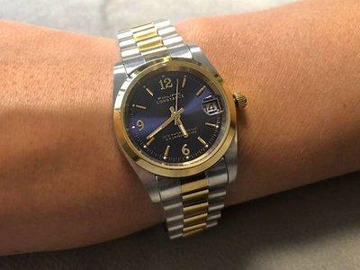 Stalen Philippe Constance Horloge Philippe Constance Stalen Dameshorloge - 7305 Medium  - Bicolor - Goud - Zilver - Indigo Blauw - Schakelband - Datumaanduiding