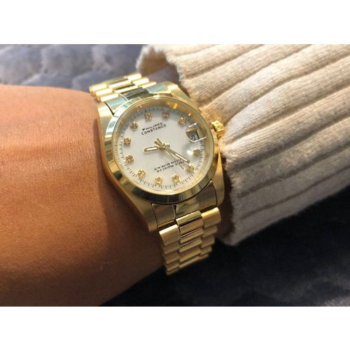 Stalen Philippe Constance Horloge Philippe Constance Stalen Dameshorloge - 7335 Medium - Goud - Parelmoer - Strass - Schakelband - Datumaanduiding