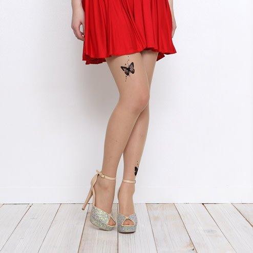 041900080 Collant tatouages papillons
