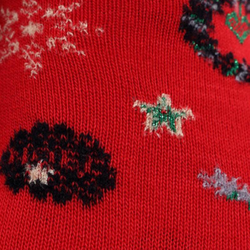 Calzino in lana con decorazioni natalizie a bordo arrotolato