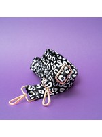 Pinned by K strap hairy leopard black white