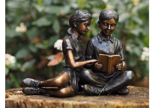 BronzArtes Lesendes Kinderpaar