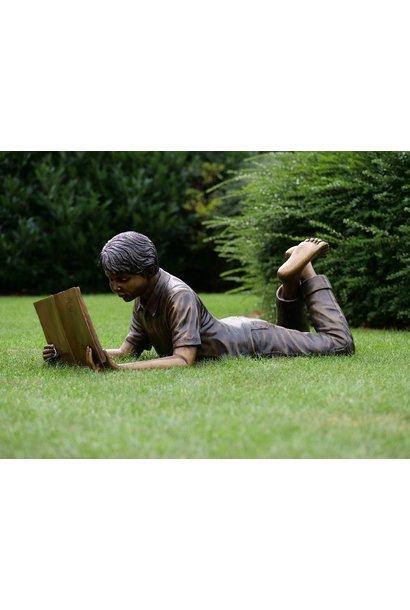 Lying reading boy