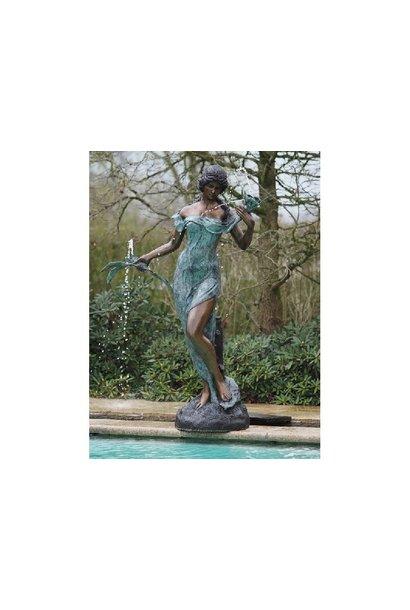 Vrouw met bloemen fontein