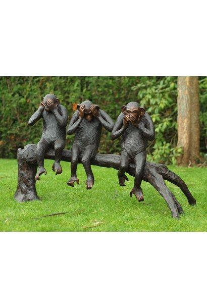 3 Monkeys on tree trunk