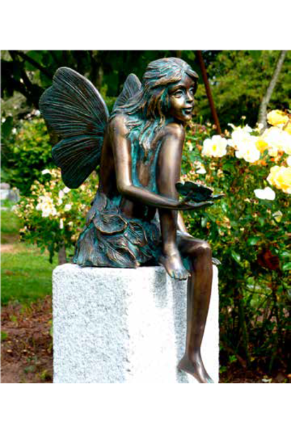 Fairy sitting with butterfly