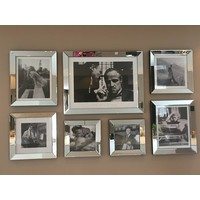 Set 7 spiegelfotolijsten met posters
