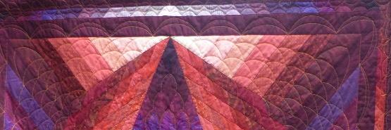 What´s Behind Ausschnitt Quilt in rot und violett