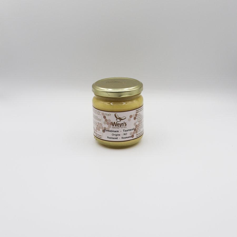 Zonnebloem honing vast