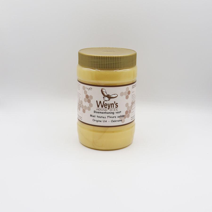 Bloemen honing vast