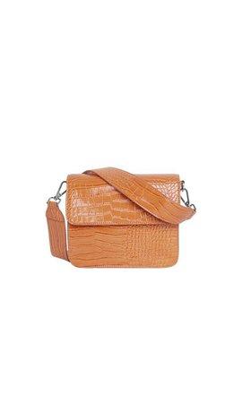 Hvisk Cayman Shiny Strap Bag Pastel Orange
