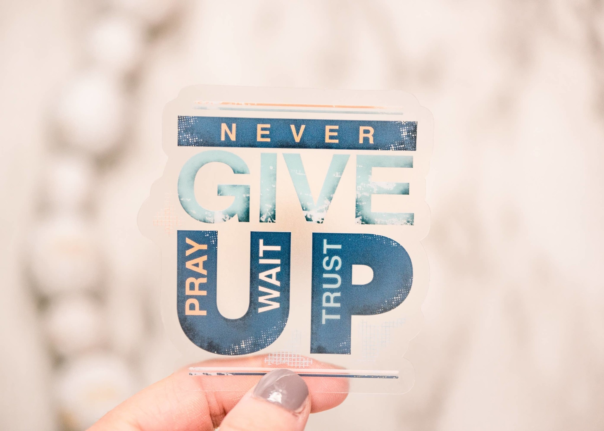 Faire: Savannah and James Co Never Give Up Clear, Vinyl Sticker, 3x3 in.