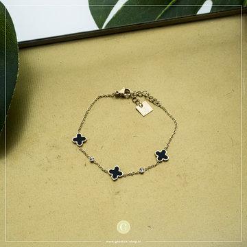 Zag Bijoux Zag Bijoux Goudkleurige Armband Zwarte Kruisjes