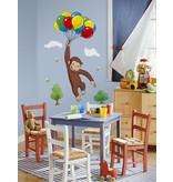 Curious George met balonnen