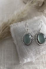 Earrings with green stone