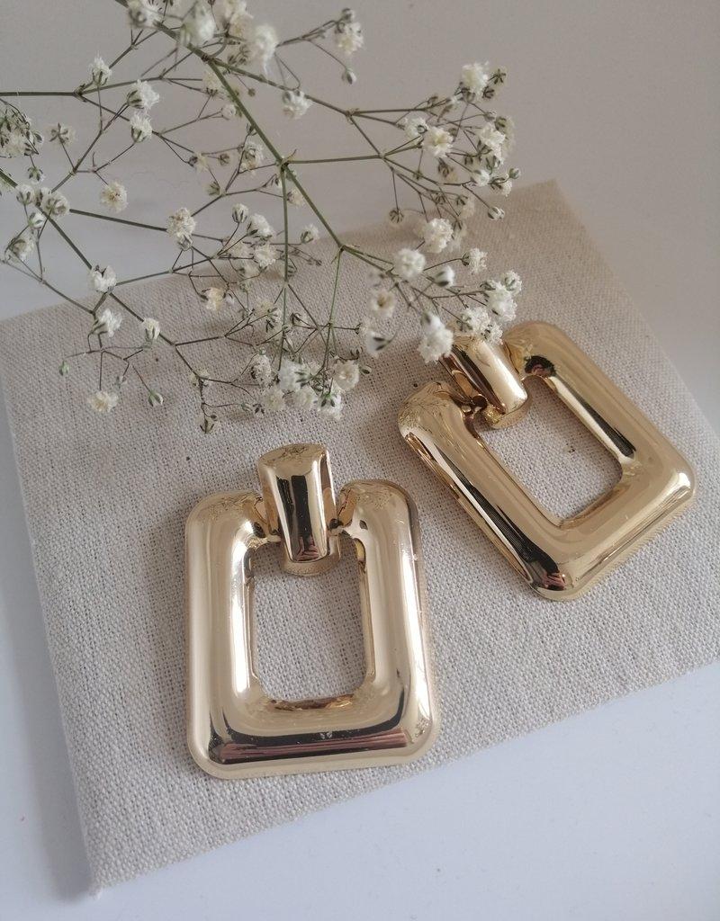 Golden statement earrings