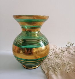 Green vase with golden details