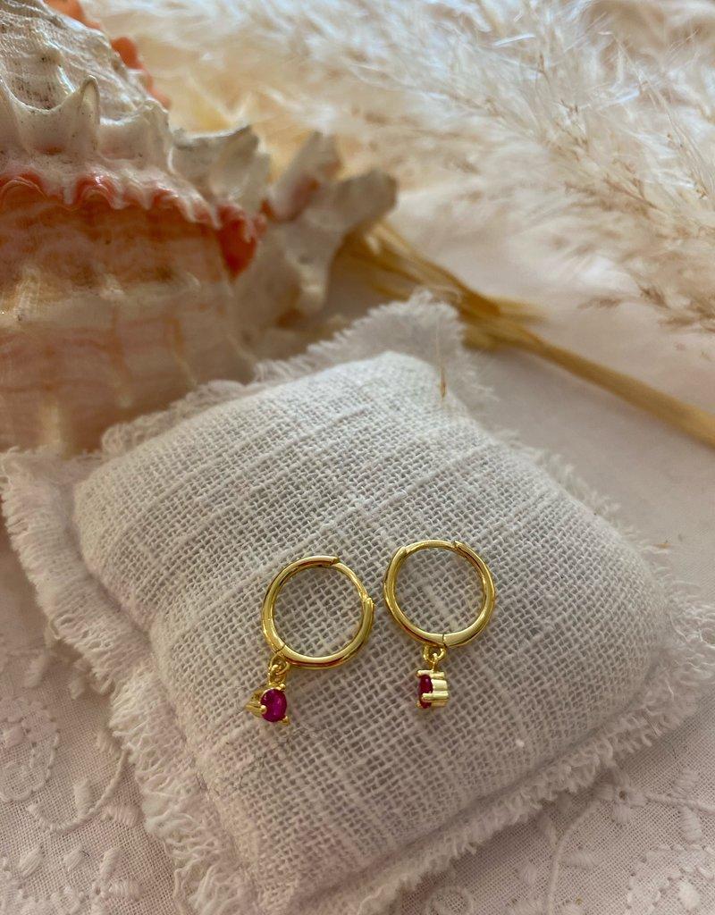 Little earrings with purple glass stone
