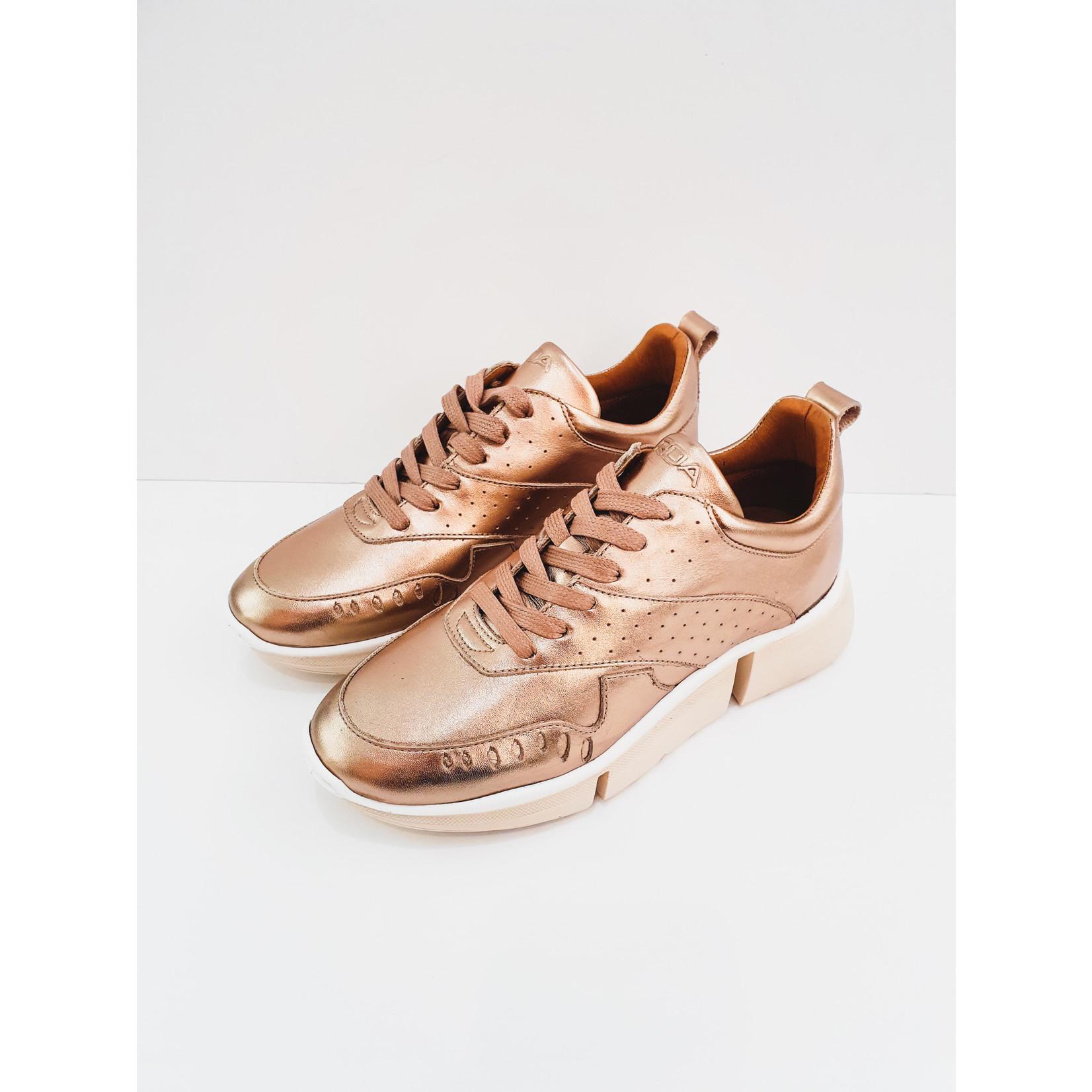 De gouden sneaker