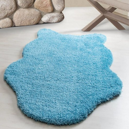 FLUFFY DECORATIE VACHT TURQUOISE
