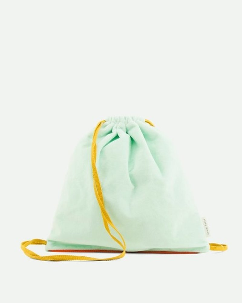 Sticky Lemon Drawstring bag teddy powder blue + caramel fudge + sporty red