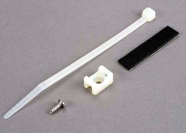 Attachment bracket, plug/ foam tape/tie wrap/ 3x10mm wst scr, TRX4577-1