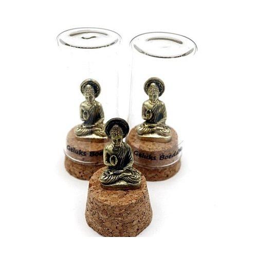 Bronzen geluks boeddha in stolp