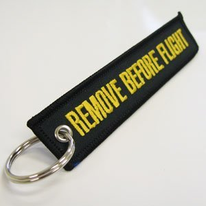 Diecast Trading Remove Before Flight Tag Black